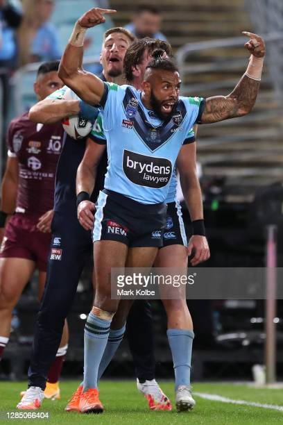 Josh Addo-Carr of the Blues celebrates with team mates after scoring a try during game two of the 2020 State of Origin series between the New South...