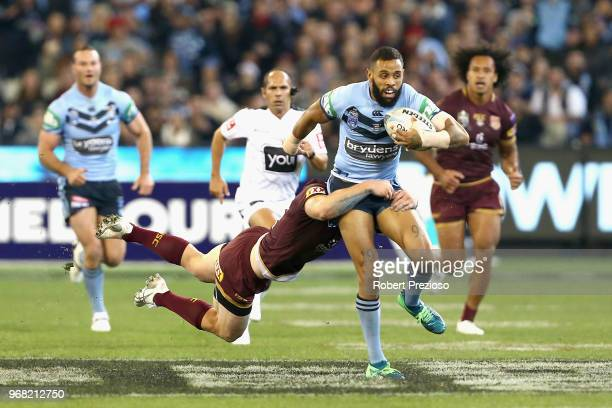 Josh AddoCarr of the Blues is tackled during game one of the State Of Origin series between the Queensland Maroons and the New South Wales Blues at...