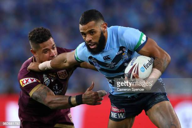 Josh AddoCarr of the Blues is tackled during game two of the State of Origin series between the New South Wales Blues and the Queensland Maroons at...