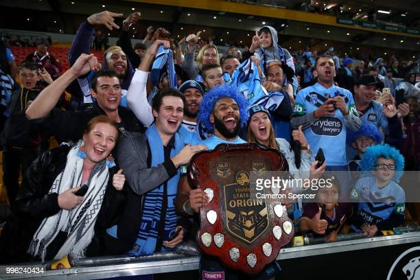 Josh AddoCarr of the Blues poses with fans after winning the series following game three of the State of Origin series between the Queensland Maroons...