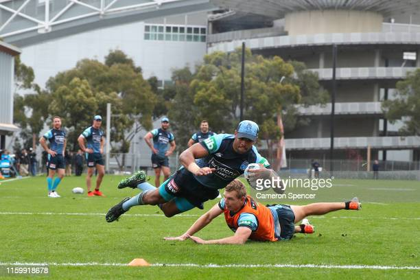 Josh AddoCarr of the Blues scores a try during a drill during a New South Wales Blues State of Origin training session at the NSWRL Centre of...
