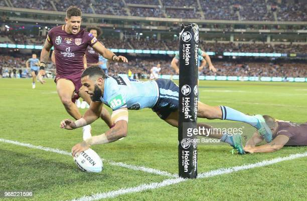 Josh AddoCarr of the Blues scores a try during game one of the State Of Origin series between the Queensland Maroons and the New South Wales Blues at...