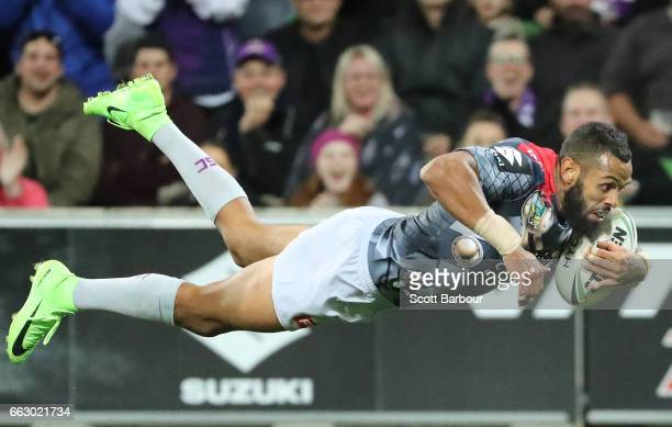 Josh AddoCarr of the Melbourne Storm dives to score a try during the round five NRL match between the Melbourne Storm and the Penrith Panthers at...