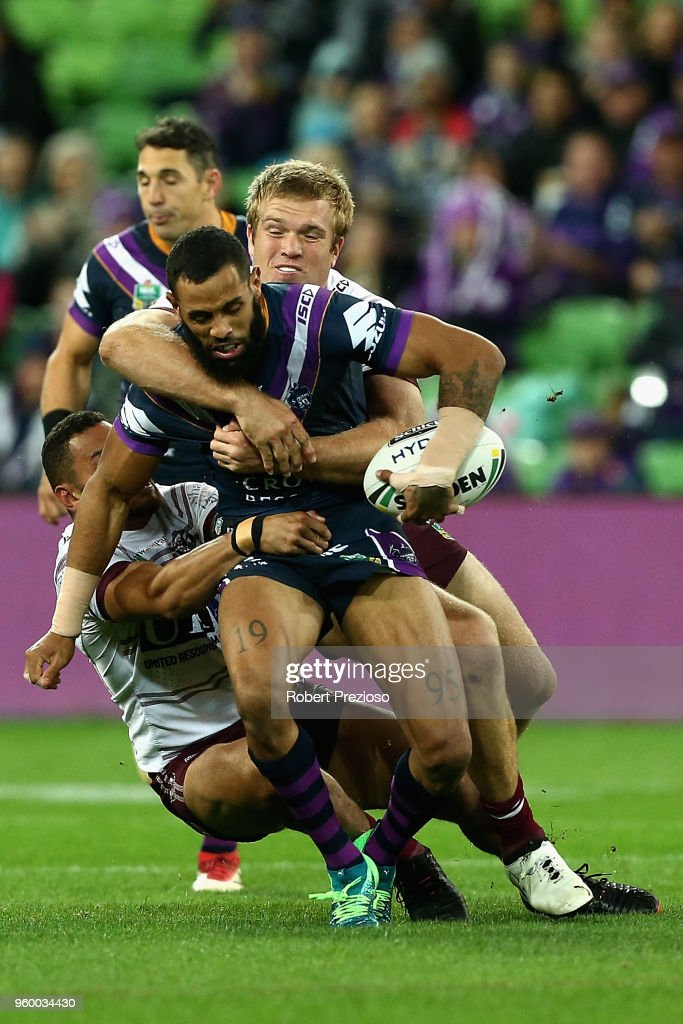 Josh Addo-Carr of the Melbourne Storm is tackled during the round 11 NRL match between the Melbourne Storm and the Manly Sea Eagles at AAMI Park on May 19, 2018 in Melbourne, Australia.