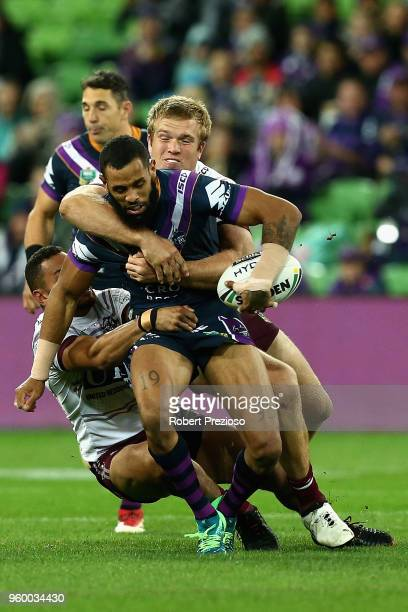 Josh AddoCarr of the Melbourne Storm is tackled during the round 11 NRL match between the Melbourne Storm and the Manly Sea Eagles at AAMI Park on...