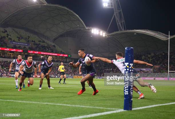 Josh AddoCarr of the Melbourne Storm scores a try during the round 6 NRL match between the Melbourne Storm and the Sydney Roosters at AAMI Park on...