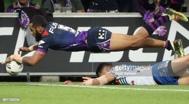 Josh AddoCarr of the Melbourne Storm scores a try during the round eight NRL match between the Melbourne Storm and New Zealand Warriors at AAMI Park...