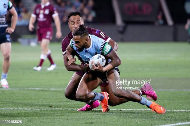 Josh Addo-Carr of the NSW Blues is tackled by Felise Kaufusi of the QLD Maroons during game one of the 2020 State of Origin series between the...