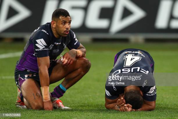 Josh AddoCarr of the Storm and Justin Olam of the Storm look on after the Storm's loss during the round 19 NRL match between the Melbourne Storm and...
