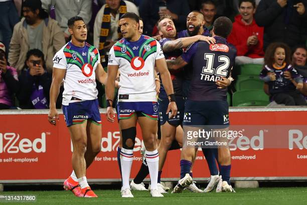Josh Addo-Carr of the Storm celebrates after scoring a try during the round seven NRL match between the Melbourne Storm and the New Zealand Warriors...