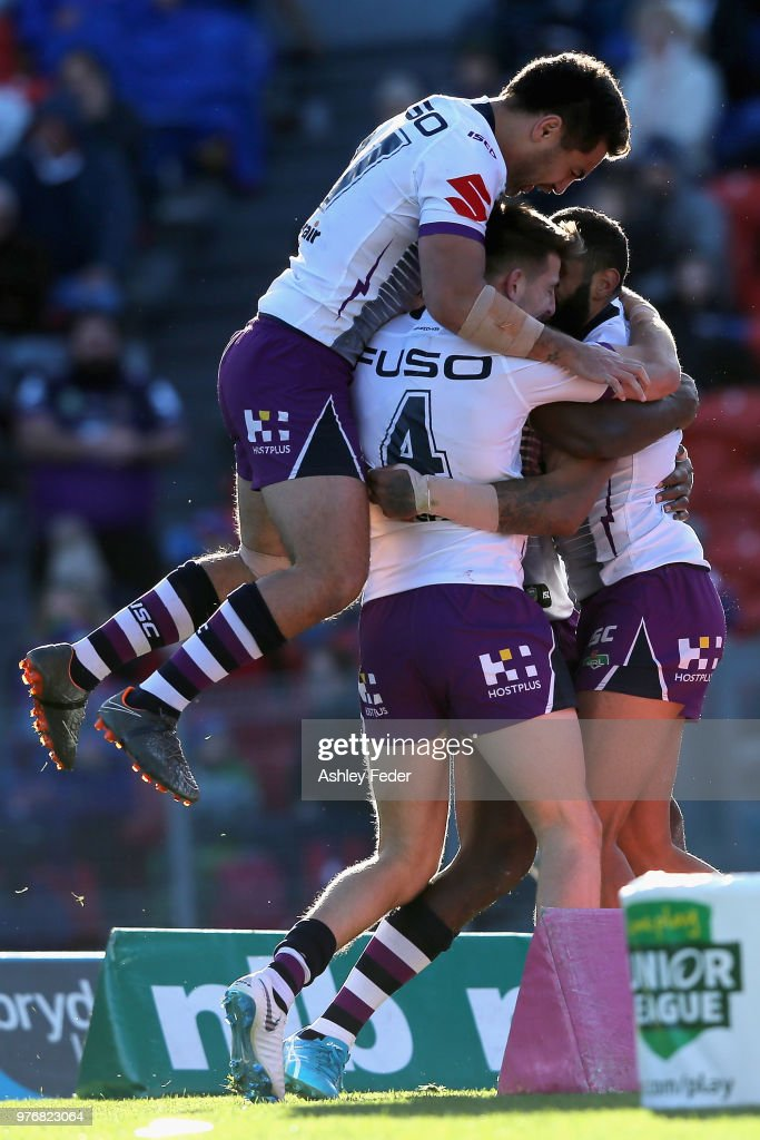 Josh Addo-Carr of the Storm celebrates his try with team mates during the round 15 NRL match between the Newcastle Knights and the Melbourne Storm at McDonald Jones Stadium on June 17, 2018 in Newcastle, Australia.