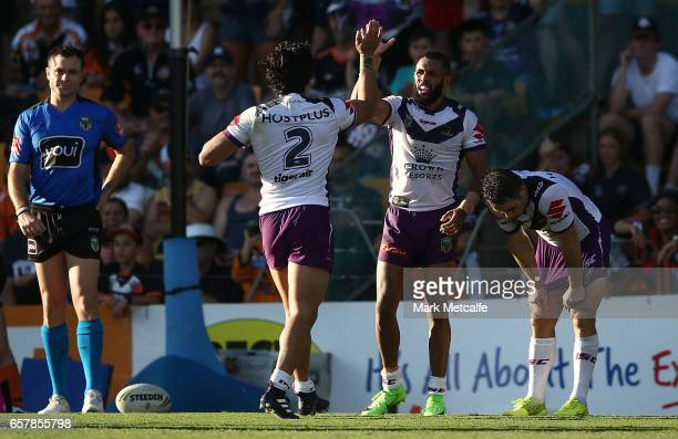 Josh AddoCarr of the Storm celebrates scoring a try during the round four NRL match between the Wests Tigers and the Melbourne Storm at Leichhardt...