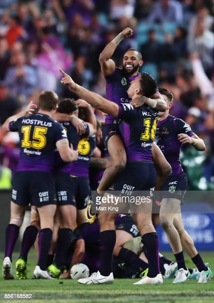 Josh AddoCarr of the Storm celebrates victory with team mates at the final siren during the 2017 NRL Grand Final match between the Melbourne Storm...