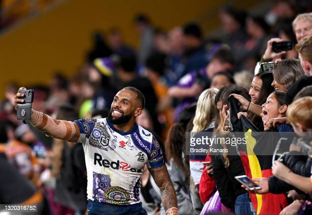 Josh Addo-Carr of the Storm celebrates victory with the fans after the round 12 NRL match between the Brisbane Broncos and the Melbourne Storm at...