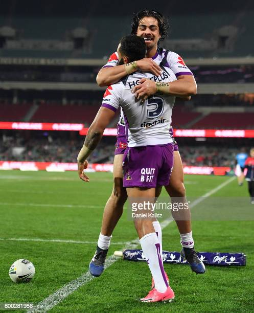 Josh AddoCarr of the Storm celebrates with his team mates after scoring a try during the round 16 NRL match between the Sydney Roosters and the...