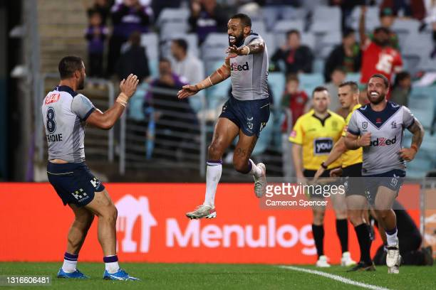 Josh Addo-Carr of the Storm celebrates with team mates after scoring his fifth try during the round nine NRL match between the South Sydney Rabbitohs...