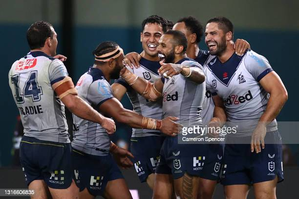 Josh Addo-Carr of the Storm celebrates with team mates after scoring his sixth try during the round nine NRL match between the South Sydney Rabbitohs...