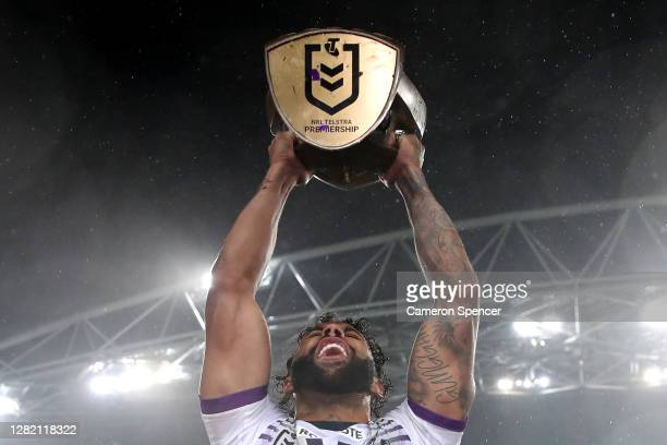 Josh Addo-Carr of the Storm holds aloft the Premiership trophy after winning the 2020 NRL Grand Final match between the Penrith Panthers and the...