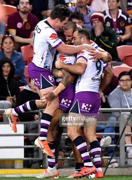Josh Addo-Carr of the Storm is congratulated by team mates after scoring a try during the round 20 NRL match between the Brisbane Broncos and the...