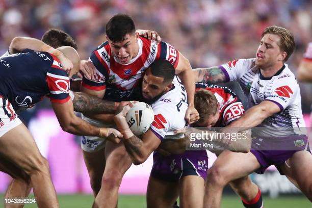 Josh AddoCarr of the Storm is tackled during the 2018 NRL Grand Final match between the Melbourne Storm and the Sydney Roosters at ANZ Stadium on...