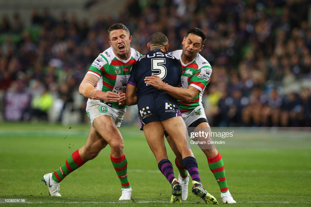 Josh Addo-Carr of the Storm (C) is tackled during the NRL Qualifying Final match between the Melbourne Storm and the South Sydney Rabbitohs at AAMI Park on September 7, 2018 in Melbourne, Australia.