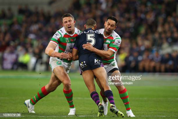 Josh AddoCarr of the Storm is tackled during the NRL Qualifying Final match between the Melbourne Storm and the South Sydney Rabbitohs at AAMI Park...