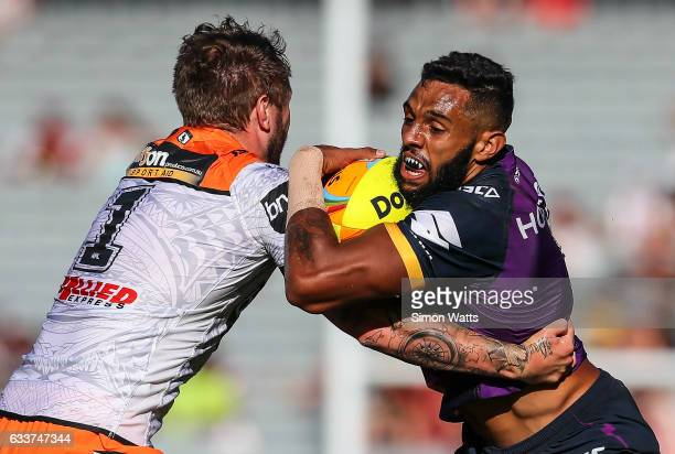 Josh AddoCarr of the Storm looks to beat a tackle during the 2017 Auckland Nines match between the Wests Tigers and the Melbourne Storm at Eden Park...