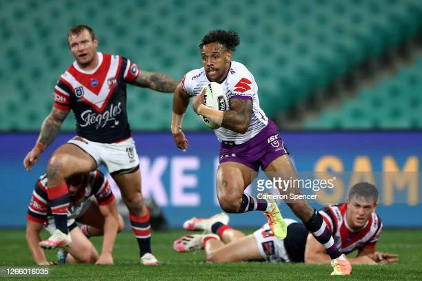 Josh Addo-Carr of the Storm makes a break during the round 14 NRL match between the Sydney Roosters and the Melbourne Storm at the Sydney Cricket...
