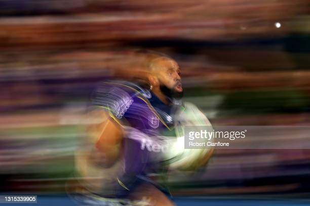 Josh Addo-Carr of the Storm makes a break to score a try during the round eight NRL match between the Melbourne Storm and the Cronulla Sharks at AAMI...