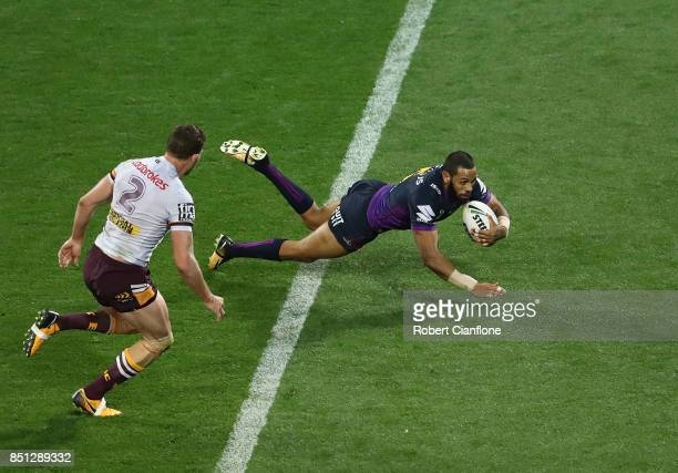 Josh AddoCarr of the Storm scores a try during the NRL Preliminary Final match between the Melbourne Storm and the Brisbane Broncos at AAMI Park on...
