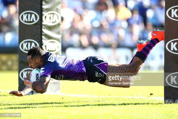 Josh AddoCarr of the Storm scores a try during the round 11 NRL match between the Canterbury Bulldogs and the Melbourne Storm at Belmore Sports...