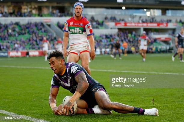 Josh AddoCarr of the Storm scores a try during the round 14 NRL match between the Melbourne Storm and the Newcastle Knights at AAMI Park on June 15...
