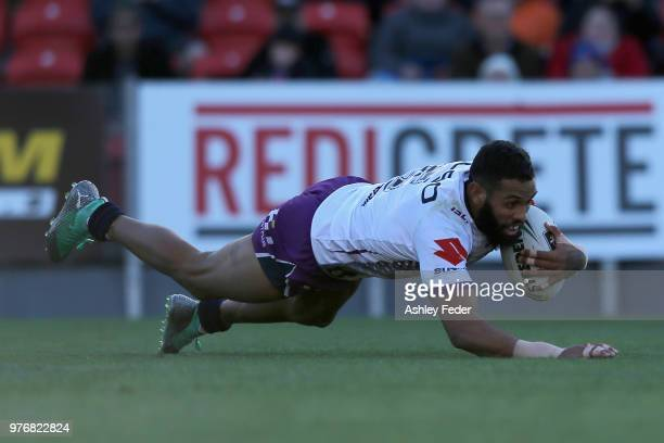 Josh AddoCarr of the Storm scores a try during the round 15 NRL match between the Newcastle Knights and the Melbourne Storm at McDonald Jones Stadium...