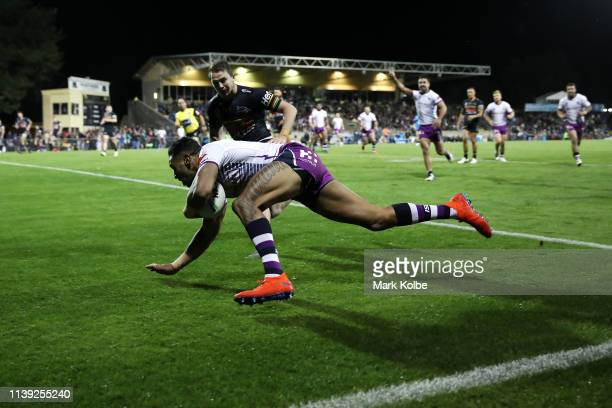 Josh AddoCarr of the Storm scores a try during the round three NRL match between the Penrith Panthers and the Melbourne Storm at Carrington Park on...