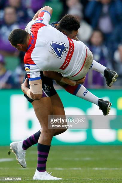Josh AddoCarr of the Storm tackles Jesse Ramien of the Knights during the round 14 NRL match between the Melbourne Storm and the Newcastle Knights at...