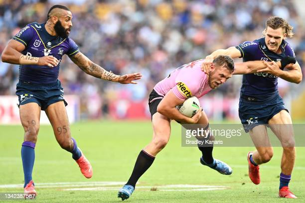 Josh Addo-Carr of the Storm watches on as Kurt Capewell of the Panthers is tackled by Ryan Papenhuyzen of the Storm during the NRL Preliminary Final...