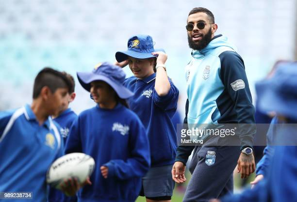 Josh AddoCarr takes part in a juniors coaching clinic during the New South Wales Blues State of Origin Team Announcement at ANZ Stadium on July 2...