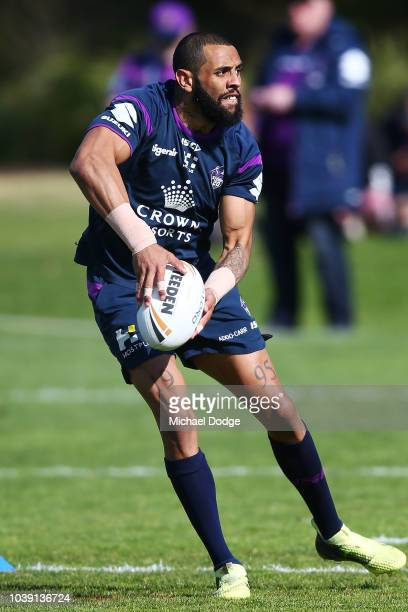 Josh AdoCarr of the Storm passes the ball during a Melbourne Storm NRL training session at Gosch's Paddock on September 24 2018 in Melbourne Australia