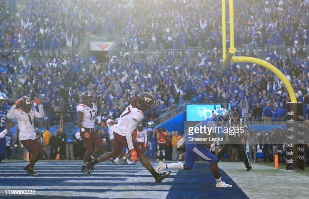 Josh Ali of the Kentucky Wildcats catches the game winning touchdown to defeat the Virginia Tech Hokies 3730 in the Belk Bowl at Bank of America...