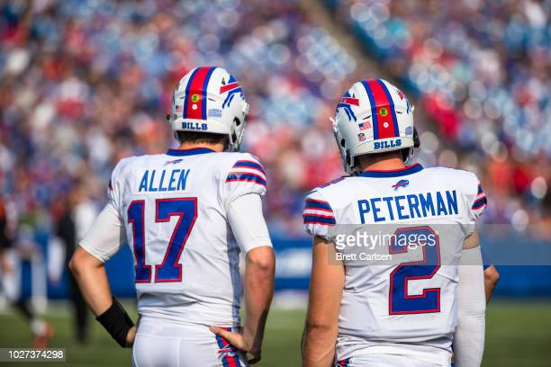 Josh Allen and Nathan Peterman of the Buffalo Bills speak with coaching staff during the preseason game against the Cincinnati Bengals at New Era...