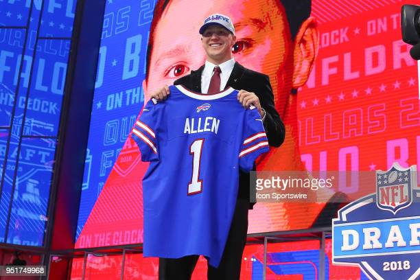 Josh Allen chosen as the seventh overall pick by the Buffalo Bills poses for photos during the first round at the 2018 NFL Draft at ATT Statium on...