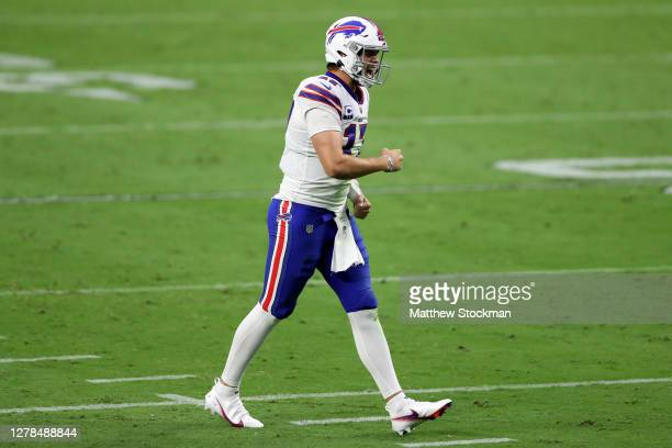 Josh Allen of the Buffalo Bills celebrates after Devin Singletary scored a two yard touchdown against the Las Vegas Raiders during the fourth quarter...