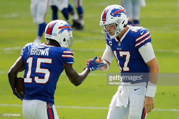 Josh Allen of the Buffalo Bills celebrates with John Brown after a 46-yard touchdown during the fourth quarter at Hard Rock Stadium on September 20,...