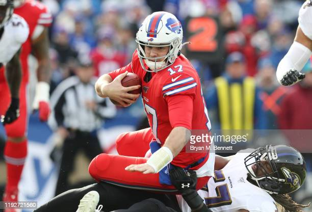 Josh Allen of the Buffalo Bills is sacked by Josh Bynes of the Baltimore Ravens during the first quarter in the game at New Era Field on December 08,...