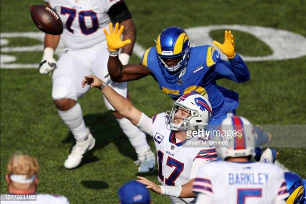 Josh Allen of the Buffalo Bills is tackled while throwing the ball during the fourth quarter against the Los Angeles Rams at Bills Stadium on...