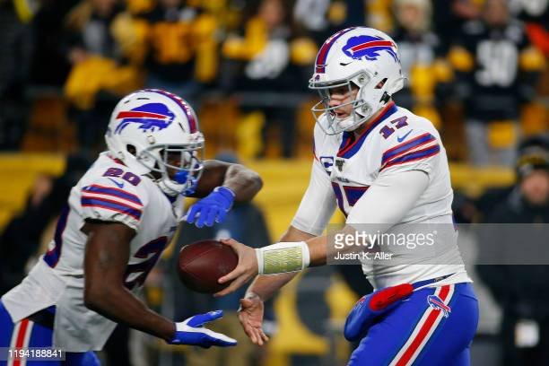 Josh Allen of the Buffalo Bills looks to hand off the ball to Frank Gore during the first half against the Pittsburgh Steelers in the game at Heinz...