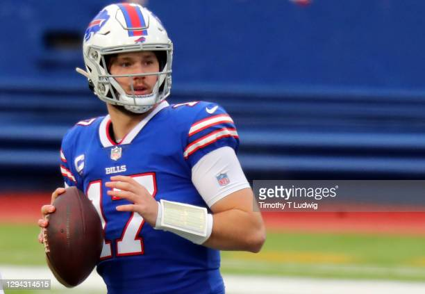 Josh Allen of the Buffalo Bills makes a pass against the Miami Dolphins during the first quartrer at Bills Stadium on January 03, 2021 in Orchard...