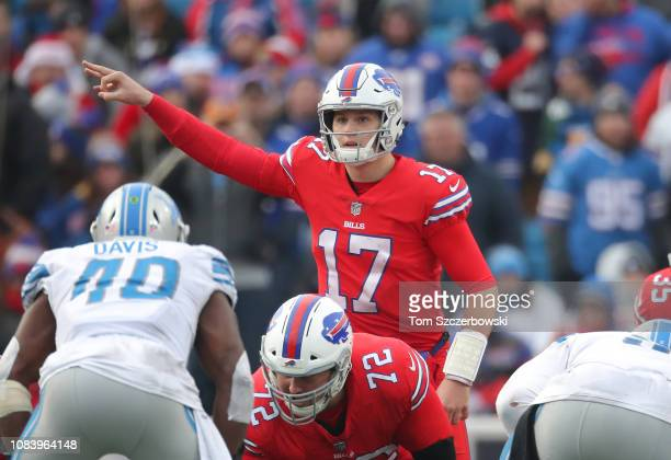 Josh Allen of the Buffalo Bills motions before receiving the snap in the third quarter during NFL game against the Detroit Lions at New Era Field on...