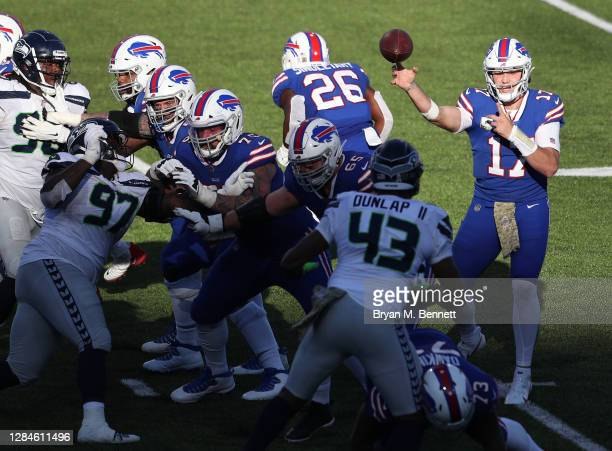 Josh Allen of the Buffalo Bills passes during the second half against the Seattle Seahawks at Bills Stadium on November 08, 2020 in Orchard Park, New...