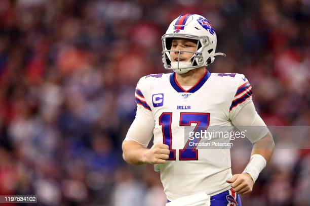 Josh Allen of the Buffalo Bills reacts after his 16-yard touchdown reception against the Houston Texans during the first quarter of the AFC Wild Card...